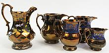 COPPER LUSTER PITCHERS.  Five.  19th century.