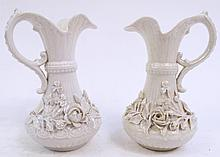 PAIR OF SIMILAR BELLEEK EWERS. One black mark and