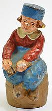 LITTLE DUTCH BOY CAST IRON BANK. Seated on a