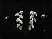 PAIR OF PLATINUM (.950 PT) EARRINGS. With 13 one