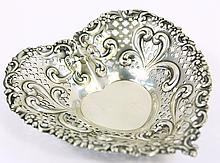 STERLING SILVER GORHAM HEART SHAPED BON-BON DISH.  With deep repousse scrolls and pierced highlights.  No monogram.  Approx. 2.45 oz. troy.  4 3/4