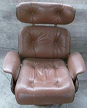 EAMES STYLE RECLINER.  Steam formed plywood and steel frame with russet leather upholstery.  (Note:  not height adjustable).