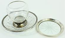 STERLING SILVER RIM TABLEWARES.  Including a wine bottle coaster, engraved glassbon bon and a 4