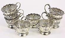 EIGHT STERLING SILVER DEMITASSE CUP HOLDERS.  Approx. 11.60 oz. troy.  (Note:  two with open bottoms).