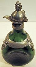 GREEN DECANTER.  With pewter overlay of grapes.  Marked Danish Silversmith.