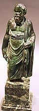 BRONZE FIGURE OF GREEK MAN.  On marble base.  14