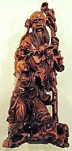 WOODEN MAN WITH CHILD ON LEG.  (Note:  intricate wood work).  16 1/2