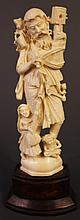 INDIAN IVORY CARVING OF A LEGENDARY HOLY MAN WITH A FOLLOWING OF CHILDREN.  Mid
