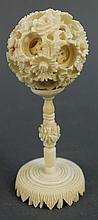 INDIAN CARVED IVORY PUZZLE BALL.  On stand.  4 1/4