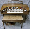 KIMBALL ELECTRIC ORGAN.  Double keyboard and full foot controls.  With bench.