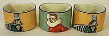 THREE UNUSUAL NORITAKE PORCELAIN NAPKIN RINGS.  Ca. 1930.  Deco figural painted