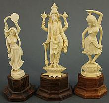 TWO INDIAN IVORY FIGURES OF TEMPLE DANCERS AND A GODDESS WITH FOUR ARMS STANDING