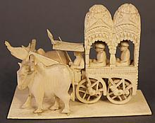 INDIAN IVORY CARVING OF TWO NOBLEMEN IN A CART DRAWN BY TWO BULLOCKS.  4