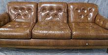 TRADITIONAL THREE CUSHION SOFA.  Buckskin tan synthetic upholstery with button