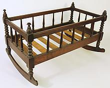 VICTORIAN DOLL CRADLE.  Spool turned walnut with rockers.  24