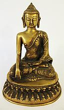 STYLISH INDIAN BRONZE FIGURE OF BUDDHA SEATED ON A STYLIZED LOTUS BASE.  11