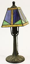PATINATED METAL DRESSER LAMP. With square leaded