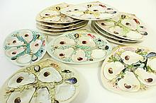 SET OF 12 OYSTER PLATES. Marked U.R.W/Patented