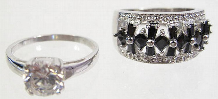TWO SILVER RINGS.  With stones.