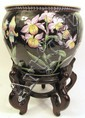 CHINESE FAMILE NOIRE PORCELAIN PLANTER ON STAND.