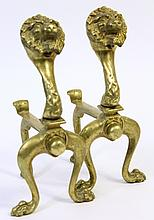 PAIR OF BRONZE LION HEAD CHENETS (FIRE DOGS). With