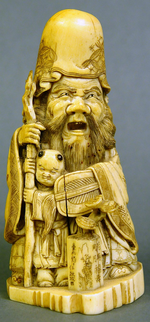 A GOOD ANTIQUE CHINESE IVORY CARVED SCHOLAR AND