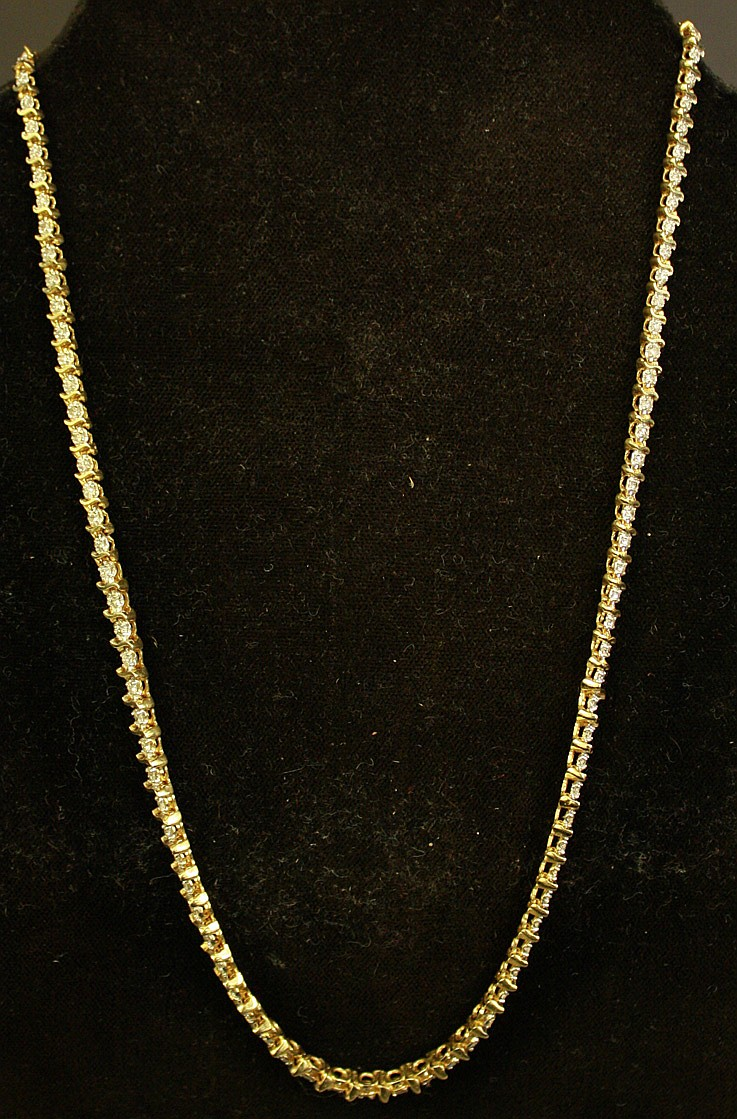 14K GOLD AND DIAMOND NECKLACE. With 113 diamonds.