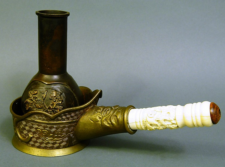 A GOOD CHINESE BRONZE IRON WITH DRAGON CARVED