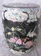 CHINESE FAMILLE NOIRE PORCELAIN GARDEN SEAT.