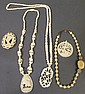 THREE IVORY NECKLACES. With pendants and two