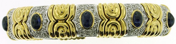 18K TWO TONE CUFF BRACELET. With five oval
