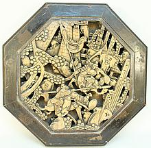 CHINESE CARVED WOOD BATTLE SCENE OF OCTAGONAL FORM.  Open carved and mounted to