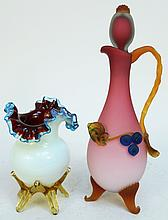 VICTORIAN STYLE SATIN GLASS CRUET WITH APPLIED DECORATION AND A FOOTED ART GLASS