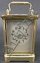 WATERBURY BRASS AND BEVELED GLASS CARRIAGE CLOCK.