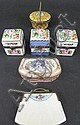 FIVE PORCELAIN HAND PAINTED HINGED BOXES.
