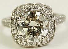 LADY'S 2.80 CARAT DIAMOND RING.- SET IN A PLATINUM HALO-STYLE MOUNTING.