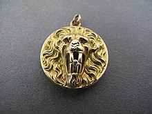 10K GOLD LION HEAD LOCKET.  Roaring with a four point diamond in his mouth and t iny ruby eyes.  15/16