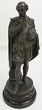 WILLIAM SHAKESPEARE FIGURE OF THE AUTHOR ON WOOD PLINTH.  With bronze plated whi te metal.  18 1/2