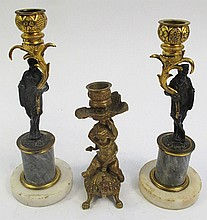 PAIR OF FRENCH EMPIRE FIGURAL CANDLESTICKS.  Early 19th century.  Bronze and ala baster.  9 1/2