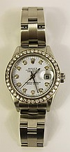 LADIES ROLEX WRISTWATCH. DATE JUST, MODEL #79-160, CIRCA 2000.With a diamond set bezel with 40 one point diamonds and 10 diamonds on the time points.Matching factory stainless bracelet
