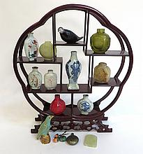 Assorted Set Of Sixteen Chinese Items. Ten Snuff Bottles, Three Snuff Bottle Lids, Two Birds, One Jade Piece