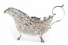 Kirk repousse sterling silver gravy boat