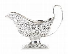 Kirk repousse coin silver gravy boat
