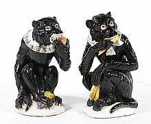 Pair of Continental glazed terracotta monkeys