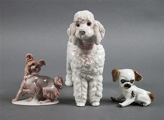Lladro porcelain poodle, Rosenthal porcelain Papillion dog, and a porcelain and metal puppy figure