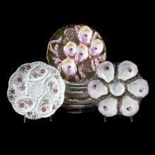 Group of nine Continental porcelain oyster plates