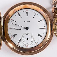 A Rose Gold Pocket Watch with Chain