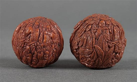 Pair of Chinese figural carved walnuts in the Ming manner