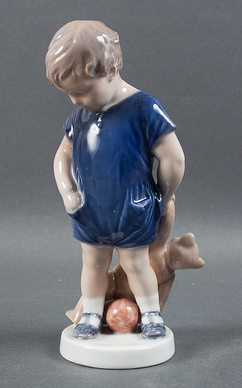 Royal Copenhagen porcelain child with teddy bear