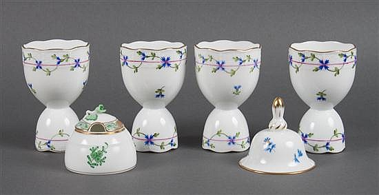 Four Herend porcelain egg cups in the